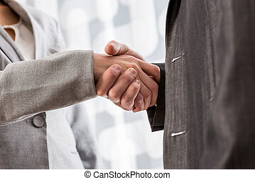Low angle closeup view of a business handshake