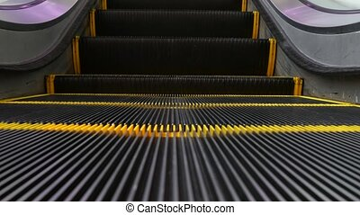 Low angle looped perspective view of modern escalator stairs...
