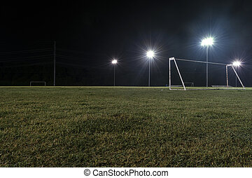 Low angle night photo of goal on empty soccer field