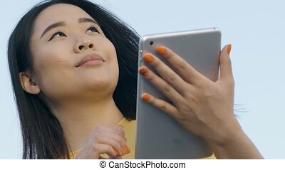 Low angle of asian business woman with touchpad