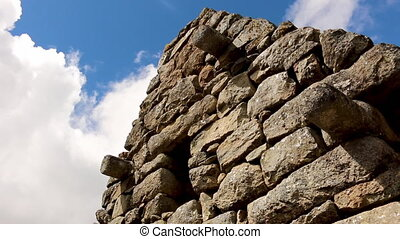 Low angle of stone structure built by incans - Low angle...