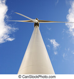 Low angle of wind turbine. - Perspective shot of wind...