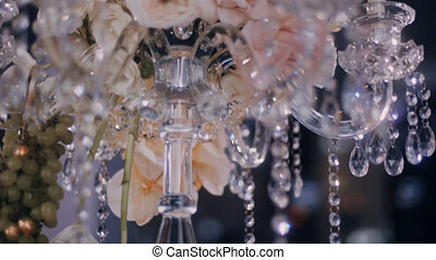 Low angle parralax shot of table candelabra decoradet with flowers