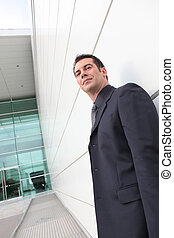 Low angle shot of a businessman outside an office block