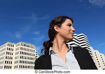 Low-angle shot of a businesswoman standing outside