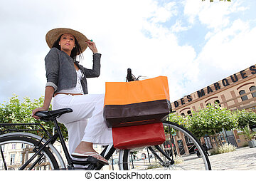 Low-angle shot of a woman on her bicycle
