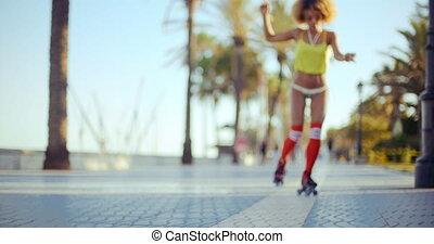 Low Angle Shot of Roller Skating Girl Riding in Bikini on...
