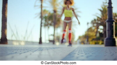 Low Angle Shot of Roller Skating Girl Riding on Tropical...