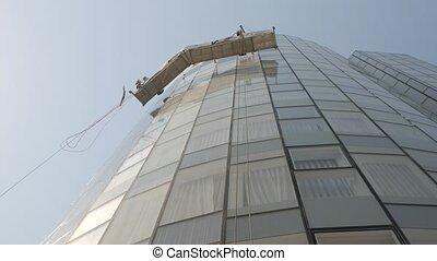Low angle shot of round skyscraper shot clip