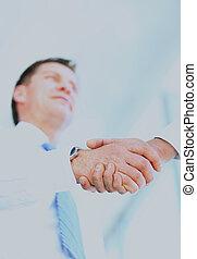 Low angle-shot of shake hands