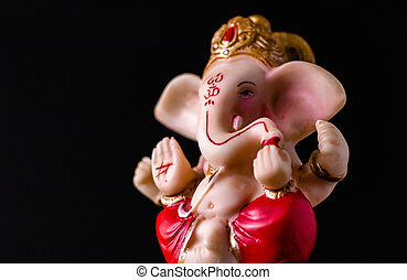 low angle side view close up of beautiful ganesha statue in blessing pose. hinduism concept.