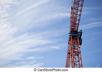 construction crane with blue sky in the background