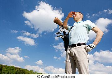 golfer against blue sky
