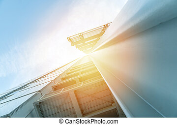 Low angle view of a skyscraper with beautiful sunlight