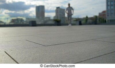 Low angle view of a sporty man running - Fasten your tempo....