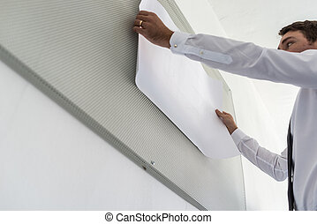 Low angle view of business leader preparing a presentation