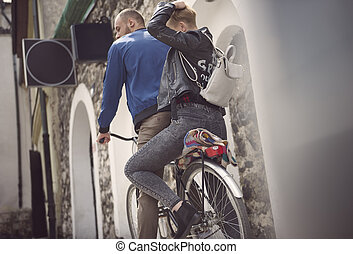 Low angle view of couple riding bicycles