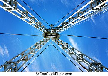 crane - Low angle view of crane on blue sky