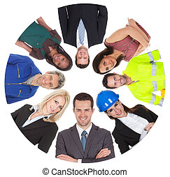 Low angle view of diverse professional group. Isolated on...