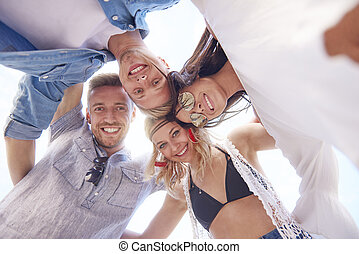 Low angle view of embracing friends