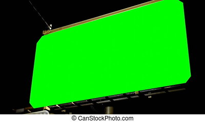 Low angle view of empty billboard with chroma key green screen at night. Darkness in background 4k