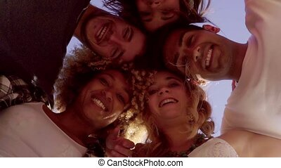 Low angle view of five friends in a huddle - Low angle view...