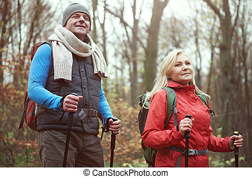 Low angle view of hiking mature couple