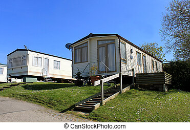 Low angle view of modern caravans in trailer park, Scarborough, England.