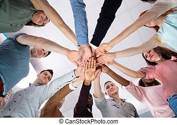 Low Angle View Of People Stacking Hand