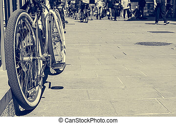 Low angle view of red bycicle parked on a square.