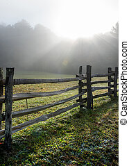 Low Angle View of Split Rail Fence and Foggy Sun Burst