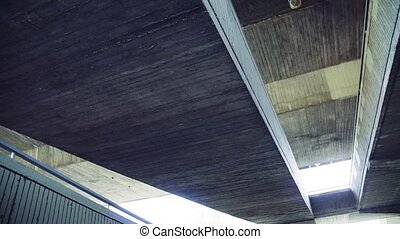 Low angle view of staircase under a bridge in a city. Slow...
