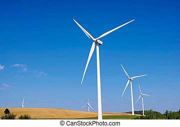 Low angle view of wind turbines in the countryside