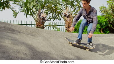 Low angle view of young caucasian man doing skateboarding trick on ramp in skateboard park 4k