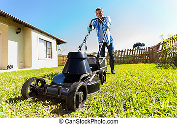 man mowing lawn at home