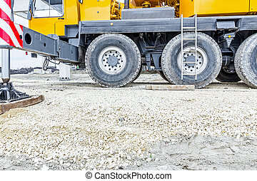 Low angle view on big crane's wheels, undercarriage