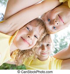 Low angle view portrait of happy children - Unusual low...