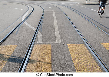 Low Angle Viewpoint of Tram Tracks on Street with Cyclist
