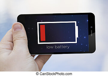 low battery cell phone - low battery concept: hand holding a...