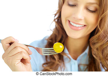 Low calorie diet - Close-up of frsh cherry tomato on fork...