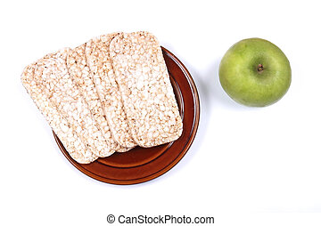 Low calorie food - Rice cakes and green apple as healthy low...