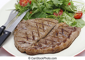 Low carb steak and salad with cutlery - Low-carb meal of ...