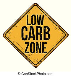 Low carb zone vintage rusty metal sign on a white...