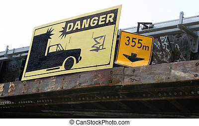Low Clearance - Warning signs above an underpass, indicating...