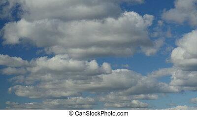 Low cumulus clouds - white cumulus clouds in blue sky time...