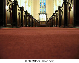 Low down the aisle - View of the altar past the pews down...