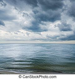 low dramatic clouds over dark water