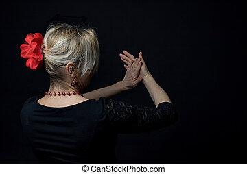 Low Key photo of Flamenco Dancer clapping in the rhythm