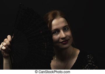 Flamenco Dancer young woman holding crochet black hand fan