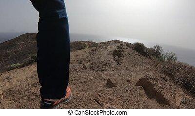 Low level footage of running across volcanic ridge above...
